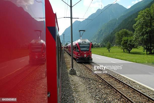 Fahrt mit Original BerninaExpress Hier in Naehe von Brusio mit Kreisviadukt Die Strecke wird stellenweise im Gegenverkehr und dichtan der Strasse...