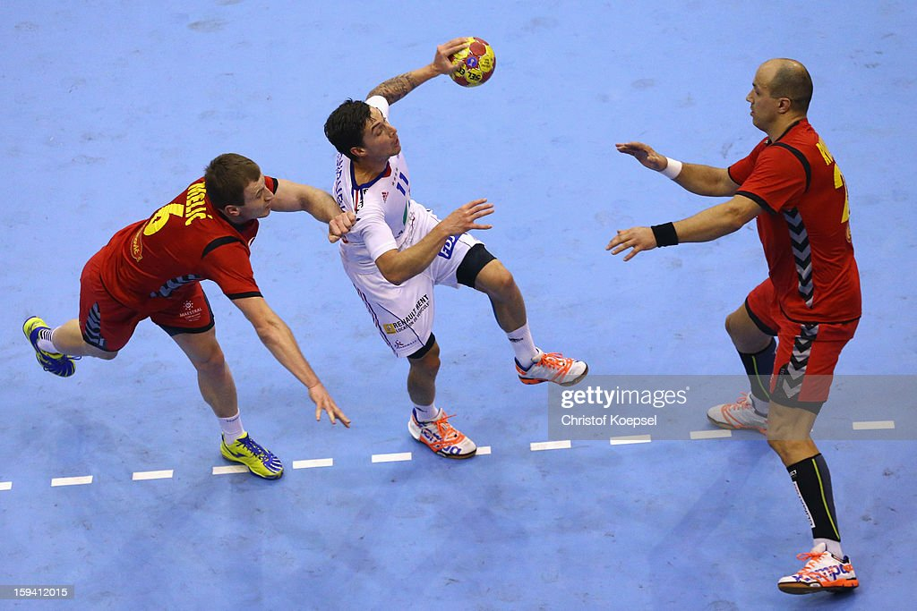 Fahrudin Melic of Montenegro (L) and Zoran Roganovic of Montenegro (R) defend against Samuel Honrubia of France (C) during the premilary group A match between Montenegro and France at Palacio de Deportes de Granollers on January 13, 2013 in Granollers, Spain.