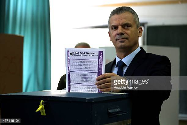 Fahrudin Radoncic leader of the Union for a Better Future party and candidate for the next term casts his vote at a polling station for the Bosnian...