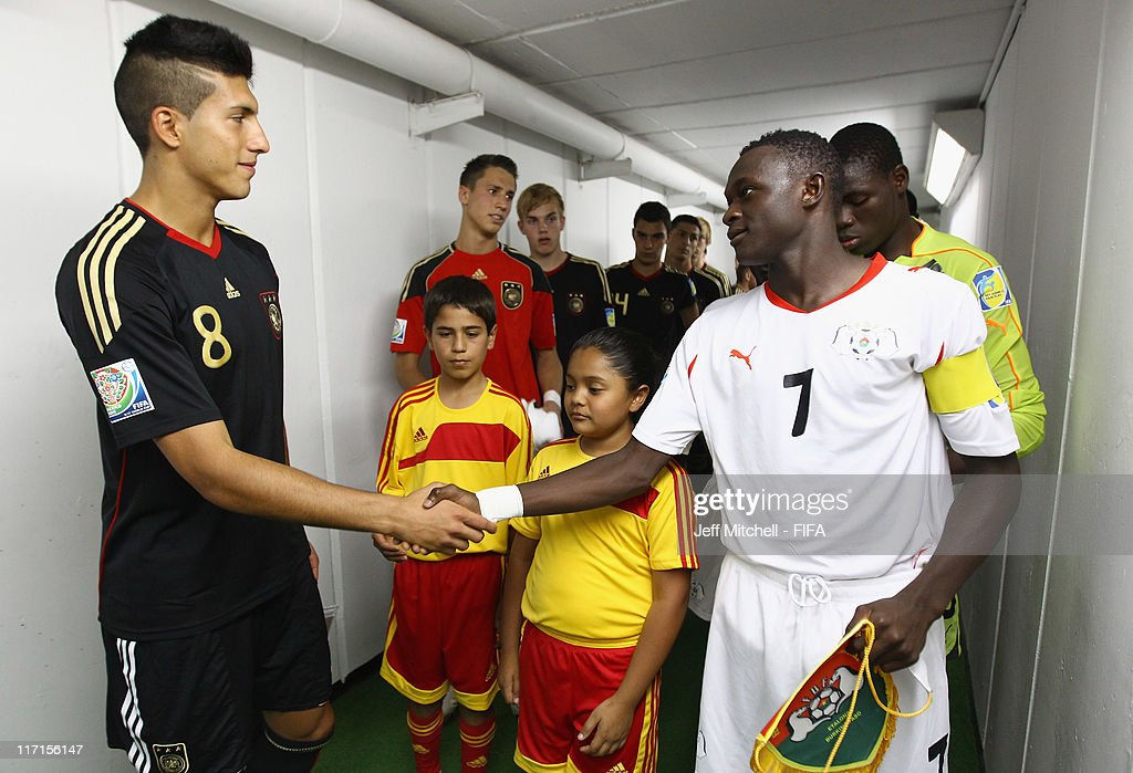 Faical Ouedraogo captain of Burkina Faso shakes hands with Emre Can captain of Germany during the Group E FIFA U-17 World Cup match between Bukino Fasa and Germany at the Corregidora Stadium on June 23, 2011 in Queretaro, Mexico.