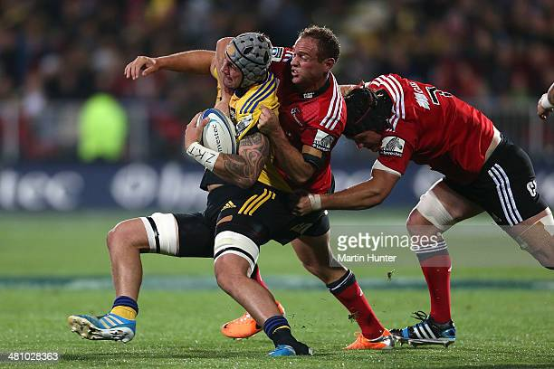 Faifili Levave of the Hurricanes is tackled by Andy Ellis of the Crusaders during the round seven Super Rugby match between the Crusaders and the...