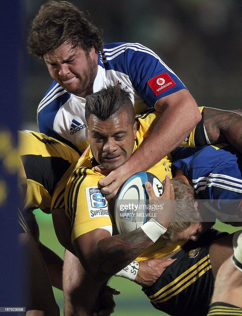 Faifili Levave of the Wellington Hurricanes (lower) is tackled by Jozua Francois Malherbe of the Western Stormers during their rugby union Super 15 match at the FMG Stadium in Palmerston North on April 26, 2013.