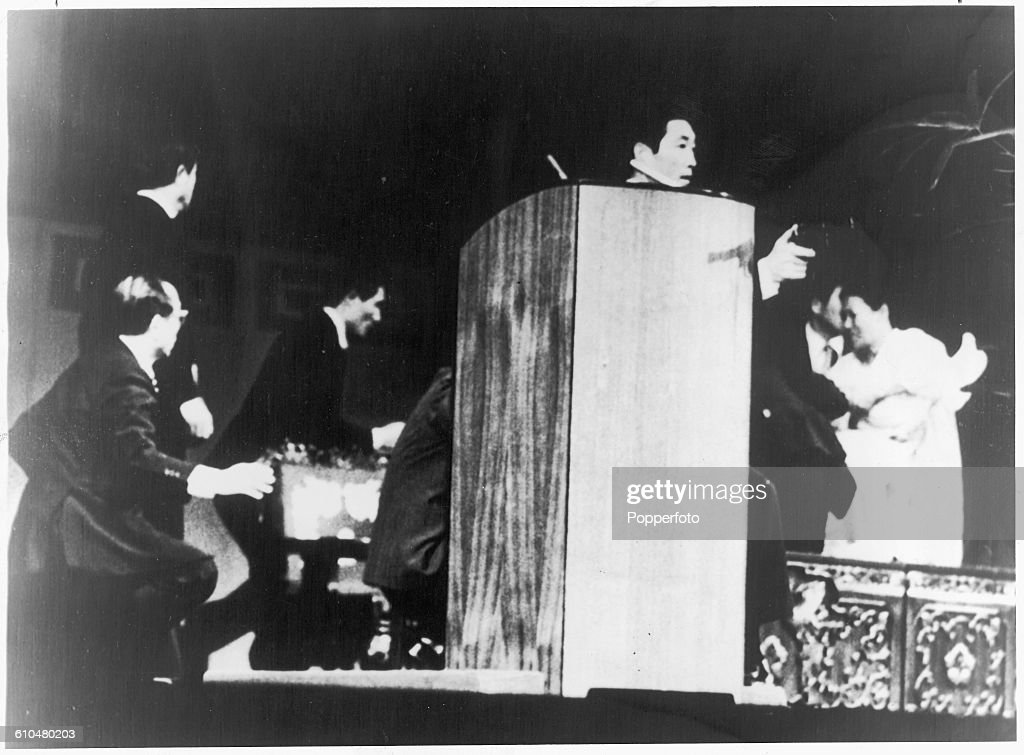 A failed assassination attempt on South Korean President Park Chung-hee at the National Theater in Seoul, 15th August 1974. The President is hidden behind the podium by his bodyguards. He was unharmed, but a bullet struck and fatally wounded his wife Yuk Young-soo (right).