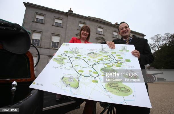 LR Failte Ireland development officer Martina O'Dwyer and Tourism Minister Leo Varadkar hold a map of the new Boyne Valley tourist route at the site...
