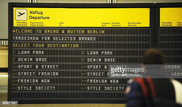 Fair information is displayed on a flight information screen in Tempelhof airport's main hall during the Bread and Butter international trade fair...