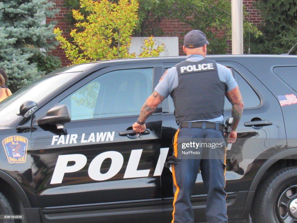 Fair Lawn Police Watch Over and Guard The Rally during Women of Action New Jersey Rally for Unity and Peace with Mayor, Councilwoman, full Borough Council and religious leaders in Fair Lawn, NJ on August 20, 2017.