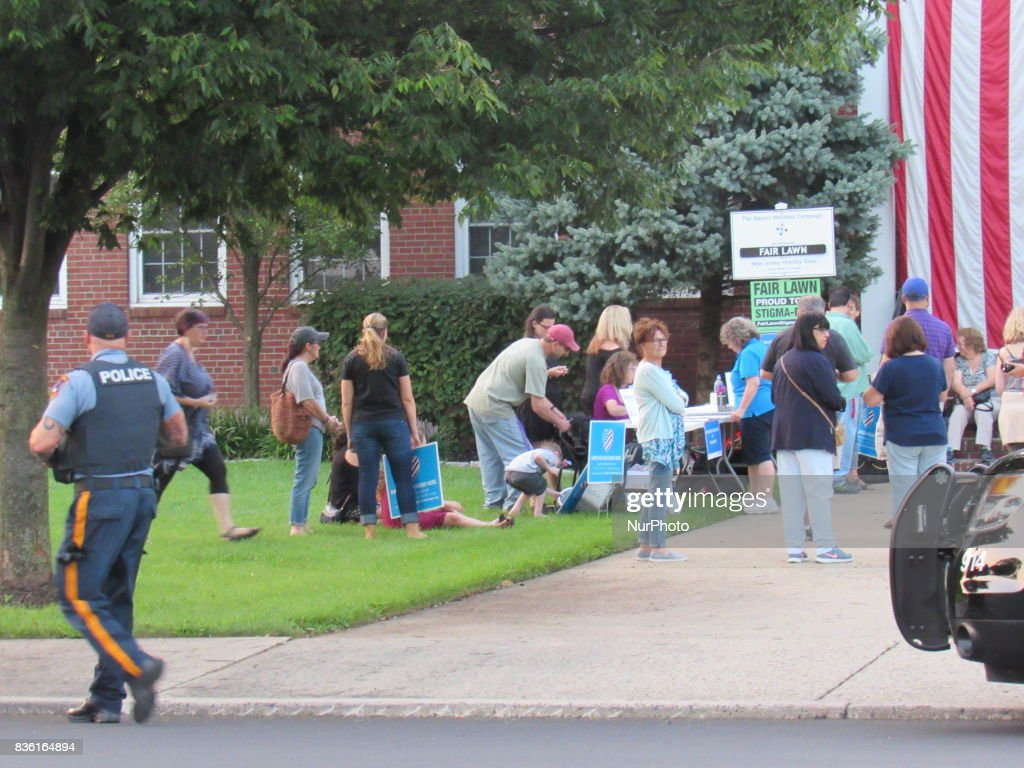 Fair Lawn Police watch over the rally and provide security during Women of Action New Jersey Rally for Unity and Peace with Mayor, Councilwoman, full Borough Council and religious leaders in Fair Lawn, NJ on August 20, 2017.