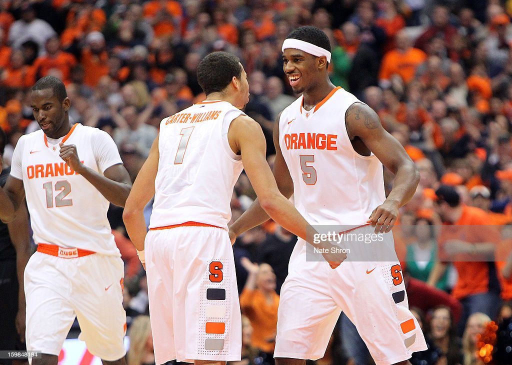 C.J. Fair #5, Michael Carter-Williams #1 and Baye Moussa Keita #12 of the Syracuse Orange celebrate against the Cincinnati Bearcats during the game at the Carrier Dome on January 21, 2013 in Syracuse, New York.