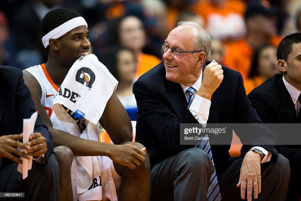 C.J. Fair #5 (L) of Syracuse Orange and head coach Jim Boeheim share a moment during the final minutes of a basketball game against Colgate Raiders on November 16, 2013 at the Carrier Dome in Syracuse, New York. Syracuse defeated Colgate 69-50.