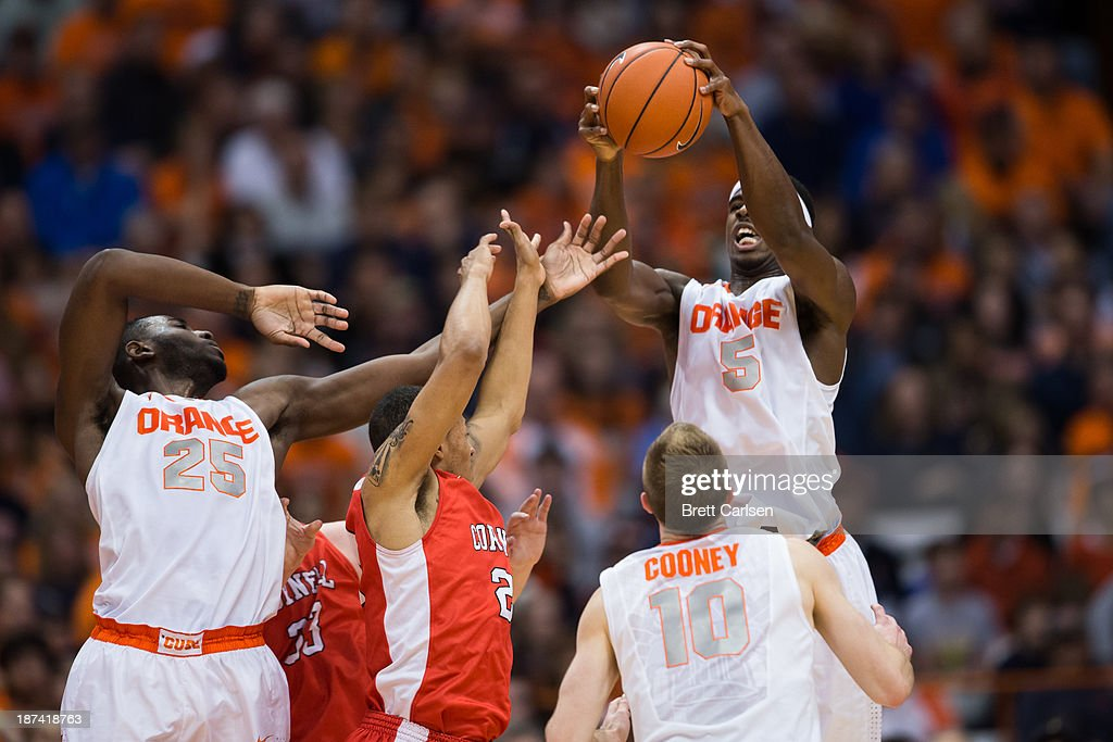 <a gi-track='captionPersonalityLinkClicked' href=/galleries/search?phrase=C.J.+Fair&family=editorial&specificpeople=7366451 ng-click='$event.stopPropagation()'>C.J. Fair</a> #5 of Syracuse Orange pulls down a loose ball during the first half of a basketball game against Cornell Big Red on November 8, 2013 at the Carrier Dome in Syracuse, New York.