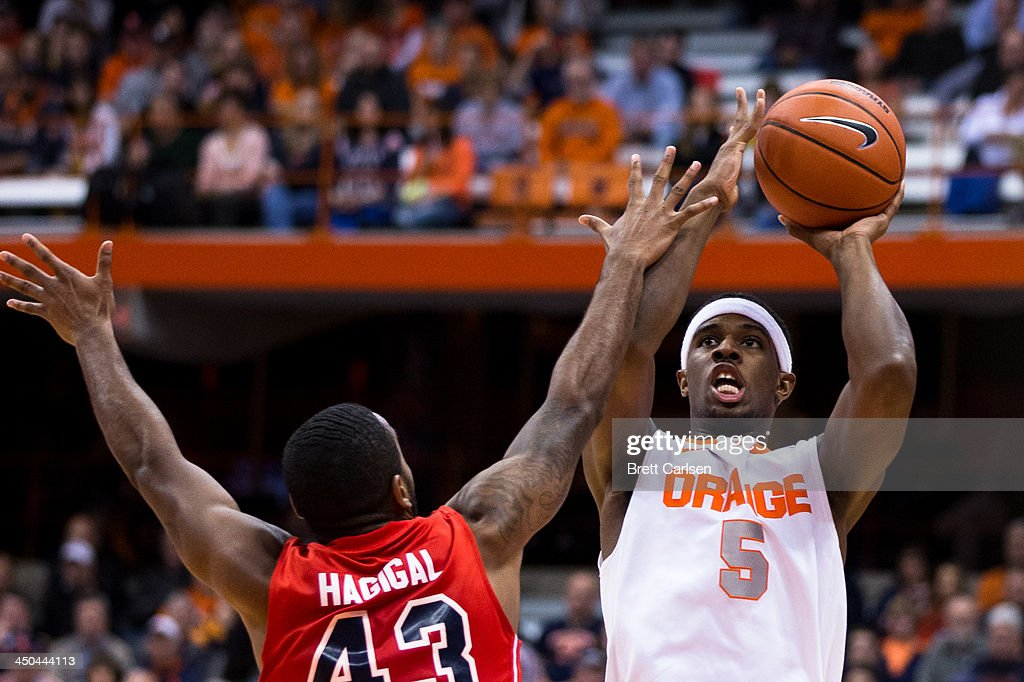 <a gi-track='captionPersonalityLinkClicked' href=/galleries/search?phrase=C.J.+Fair&family=editorial&specificpeople=7366451 ng-click='$event.stopPropagation()'>C.J. Fair</a> #5 of Syracuse Orange puts in a first half field goal over the hands of Sheldon Hagigal #43 of St Francis Terriers on November 18, 2013 at the Carrier Dome in Syracuse, New York. Syracuse wins 56-50.