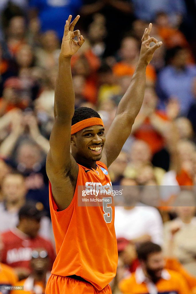 C.J. Fair #5 of the Syracuse Orange celebrates after defeating the Marquette Golden Eagles to win the East Regional Round Final of the 2013 NCAA Men's Basketball Tournament at Verizon Center on March 30, 2013 in Washington, DC.