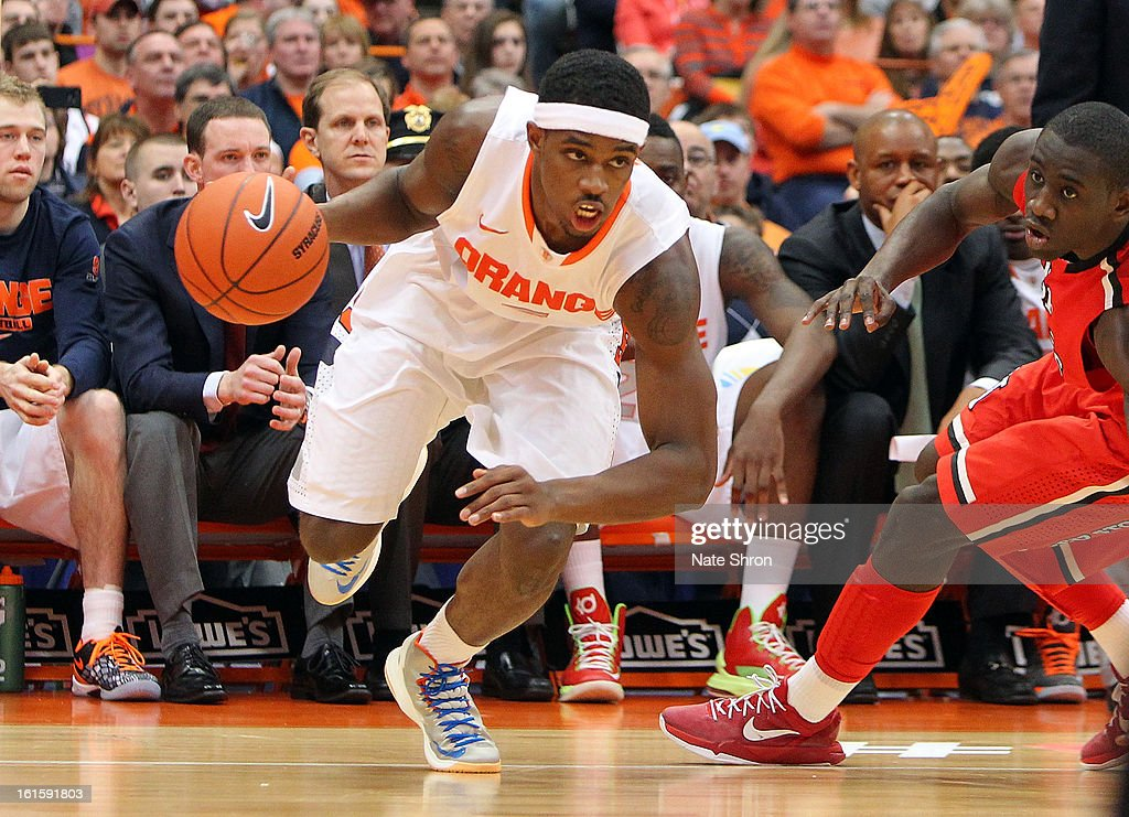 C.J. Fair #5 of the Syracuse Orange drives to the basket against Sir'Dominic Pointer #15 of the St. John's Red Storm during the game at the Carrier Dome on February 10, 2013 in Syracuse, New York.