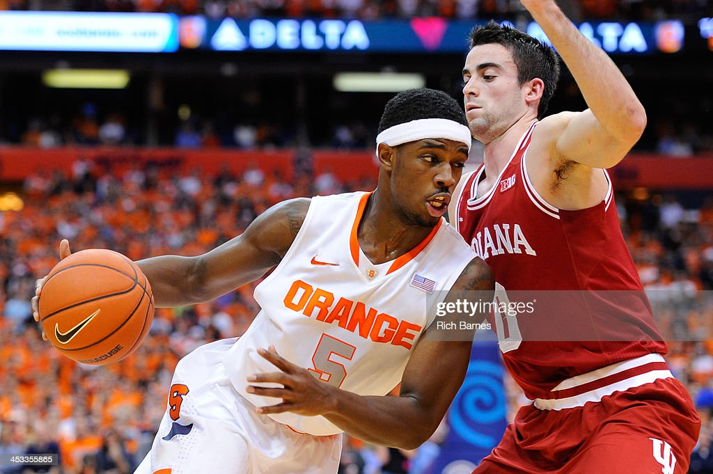 C.J. Fair #5 of the Syracuse Orange drives to the basket around Will Sheehey #0 of the Indiana Hoosiers during the first half at the Carrier Dome on December 3, 2013 in Syracuse, New York.
