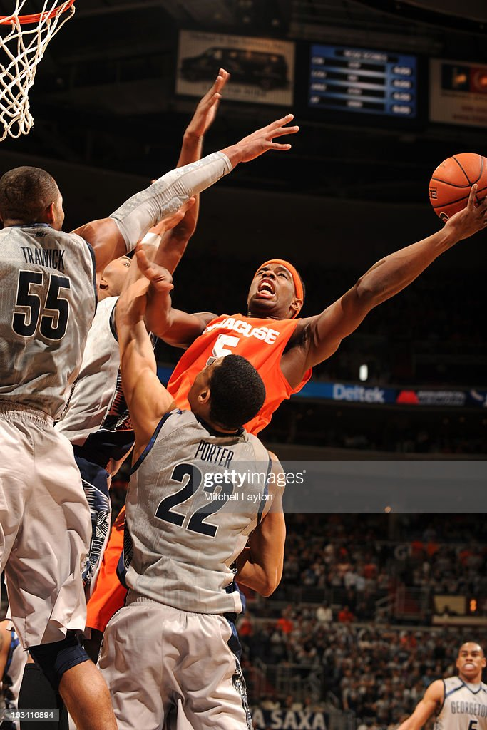 C.J. Fair #5 of the Syracuse Orange drives to the basket during a college basketball game against the Georgetown Hoyas on March 9, 2013 at the Verizon Center in Washington, DC. The Hoyas won 61-39.