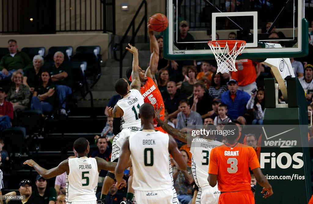 C.J. Fair #5 of the Syracuse Orange dunks over Anthony Collins #11 of the South Florida Bulls during the game at the Sun Dome on January 6, 2013 in Tampa, Florida.
