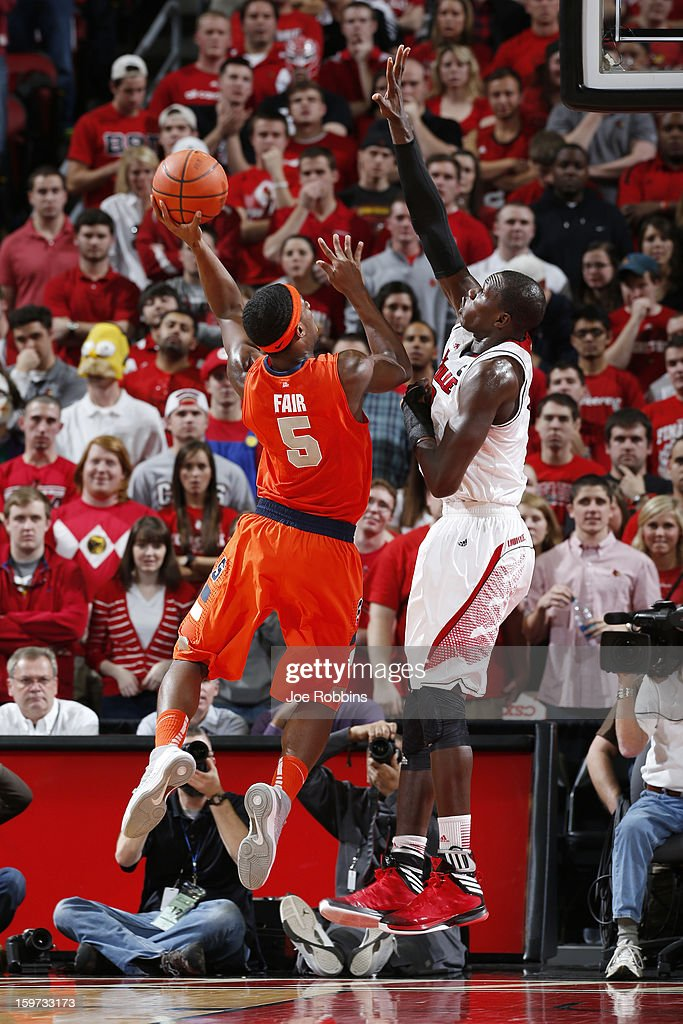 C.J. Fair #5 of the Syracuse Orange goes to the basket against Gorgui Dieng #10 of the Louisville Cardinals during the game at KFC Yum! Center on January 19, 2013 in Louisville, Kentucky. Syracuse defeated Louisville 70-68.
