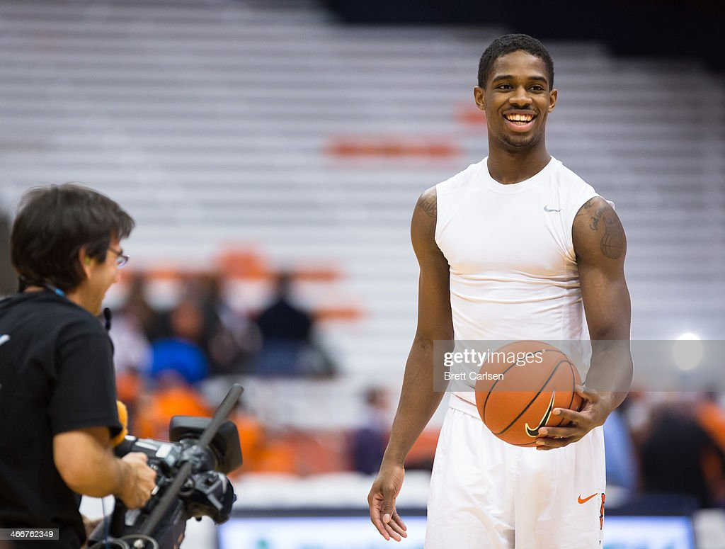 C.J. Fair #5 of the Syracuse Orange laughs as he is recorded by TV cameramen during warmups before a game against the Notre Dame Fighting Irish on February 3, 2014 at The Carrier Dome in Syracuse, New York.