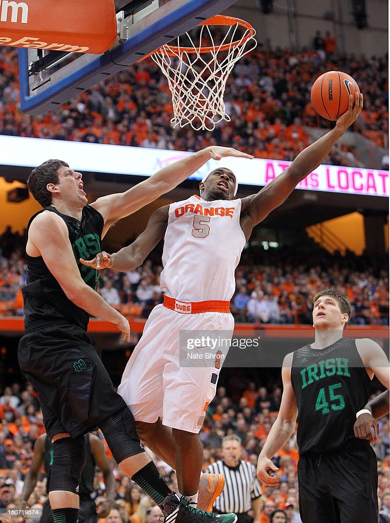 C.J. Fair #5 of the Syracuse Orange puts the ball up to the basket against Tom Knight #25 and Jack Cooley #45 of the Notre Dame Fighting Irish during the game at the Carrier Dome on February 4, 2013 in Syracuse, New York.