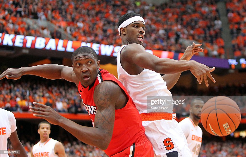 C.J. Fair #5 of the Syracuse Orange reaches for the ball against Chris Obekpa #12 of the St. John's Red Storm during the game at the Carrier Dome on February 10, 2013 in Syracuse, New York.