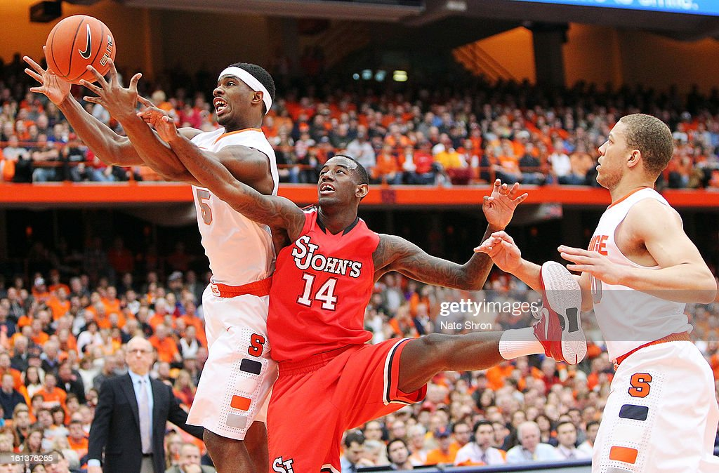 C.J. Fair #5 of the Syracuse Orange reaches for the rebound against Jakarr Sampson #14 of the St. John's Red Storm during the game at the Carrier Dome on February 10, 2013 in Syracuse, New York.