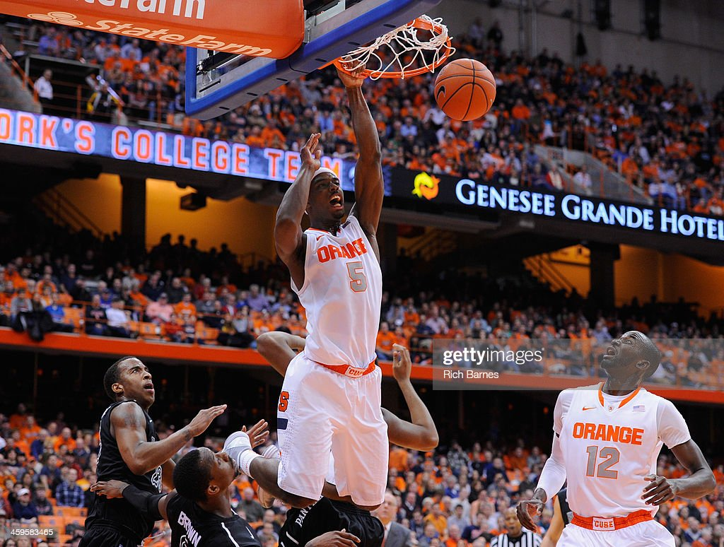C.J. Fair #5 of the Syracuse Orange reacts after dunking the ball against the High Point Panthers during the second half at the Carrier Dome on December 20, 2013 in Syracuse, New York. Syracuse defeated High Point 75-54.