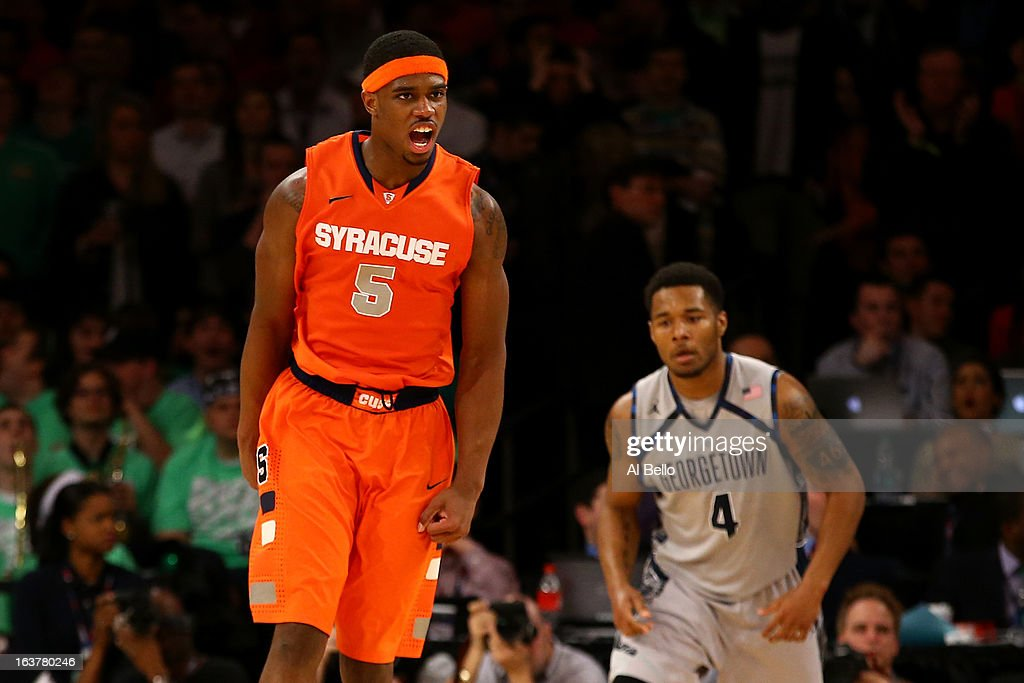 C.J. Fair #5 of the Syracuse Orange reacts after he dunked the ball against the Georgetown Hoyas during the semifinals of the Big East Men's Basketball Tournament at Madison Square Garden on March 15, 2013 in New York City.