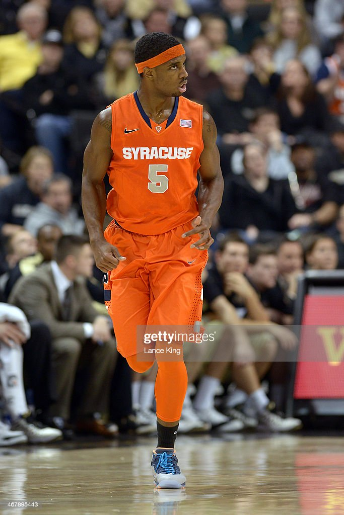 C.J. Fair #5 of the Syracuse Orange reacts following a basket against the Wake Forest Demon Deacons at Lawrence Joel Coliseum on January 29, 2014 in Winston-Salem, North Carolina. Syracuse defeated Wake Forest 67-57.