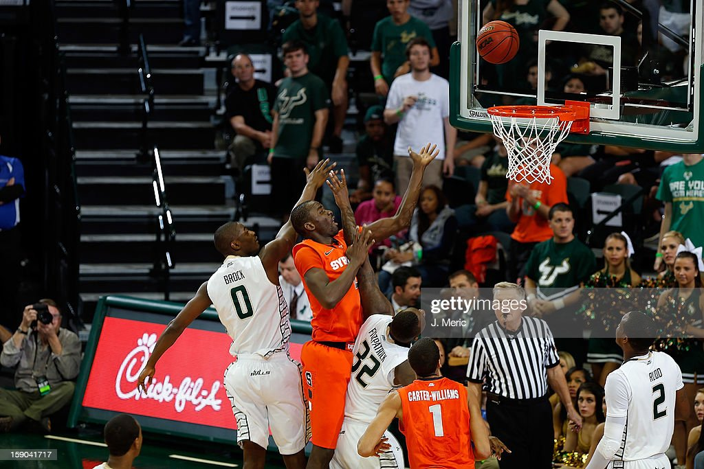 C.J. Fair #5 of the Syracuse Orange shoots as Martino Brock #0 of the South Florida Bulls defends during the game at the Sun Dome on January 6, 2013 in Tampa, Florida.