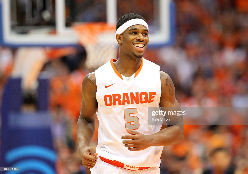 C.J. Fair #5 of the Syracuse Orange smiles as he runs on the court in celebration after a play during the game against the DePaul Blue Demons during the game at the Carrier Dome on March 6, 2013 in Syracuse, New York.
