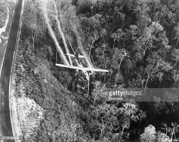 A Fairchild C123 Provider cargo plane sprays Agent Orange over a forest in North Vietnam