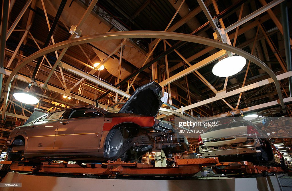 Chevrolet Malibus move through the Fairfax General Motors Assembly Plant in Fairfax, Kansas, were US President George W. Bush toured before making remarks on energy initiatives 20 March 2007. AFP PHOTO/Jim WATSON