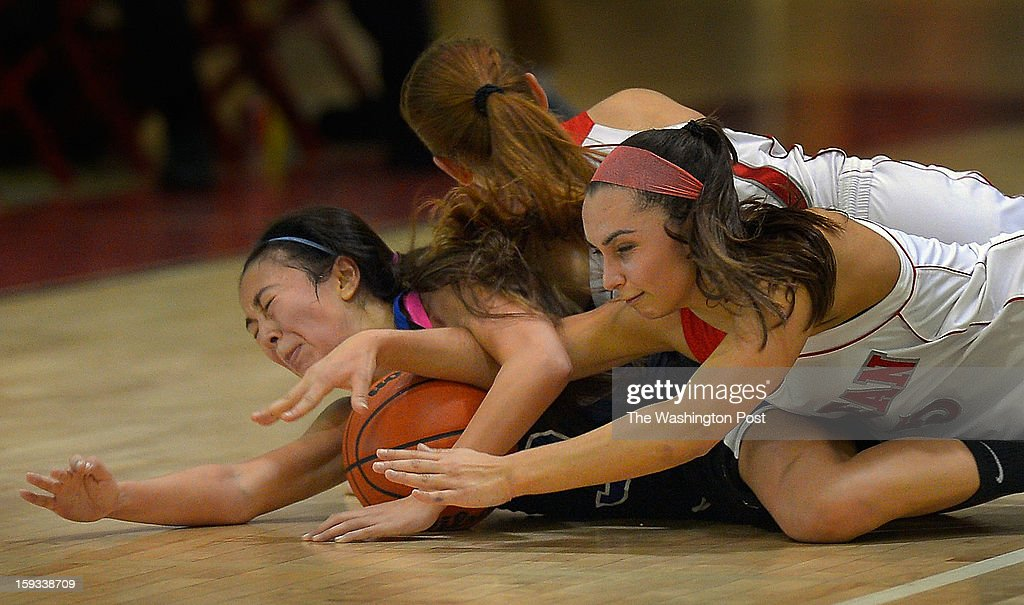 Fairfax's Alex Wendling, left, McLean's Camila Prock, center, and McLean's Elena Karakozoff, right, dive for a loose ball during McLean's defeat of Fairfax 58 - 37 in girls basketball at McLean High School in McLean VA, January 11, 2012 .