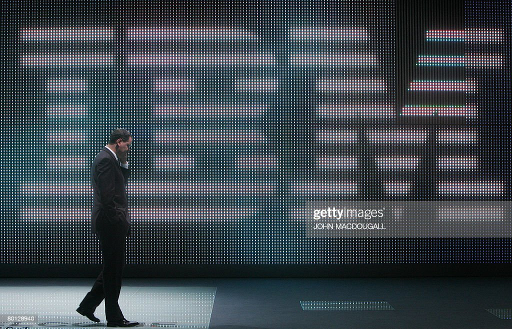 A fairgoer speaks on his mobile phone in front of a giant IBM logo at the CeBIT trade fair in Hanover on March 5, 2008. The fair officially runs from 04 to 09 March and features some 5,000 exhibitors.