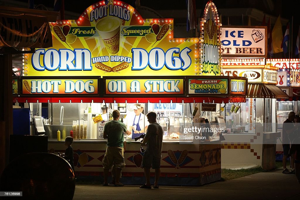 Fairgoers buy food at the Iowa State Fair August 15 2007 in Des Moines Iowa The fair runs to August 19 and is expected to draw about 1 million people