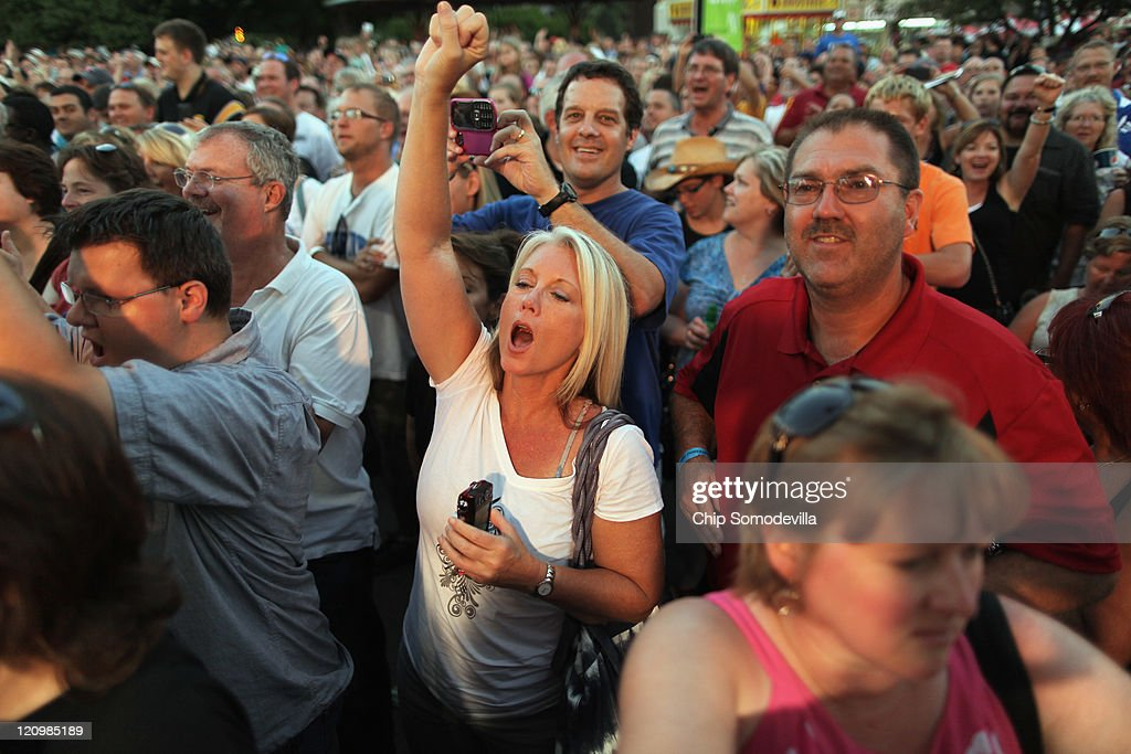 Fairgoers cheer for former Alaska Governor Sarah Palin while she appears on the Sean Hannity Show at the Iowa State Fair August 12, 2011 in Des Moines, Iowa. Although Palin has not announced any intention of running for president, she joined most of the declared Republican presidential hopefuls who are visiting the fair ahead of tomorrow's Iowa Straw Poll to greet voters and engage in the traditional Iowa campaigning ritual.