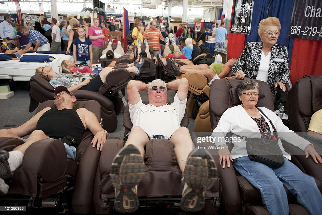 Fairgoers sample massage chairs at the Iowa State Fair in Des Moines Iowa e