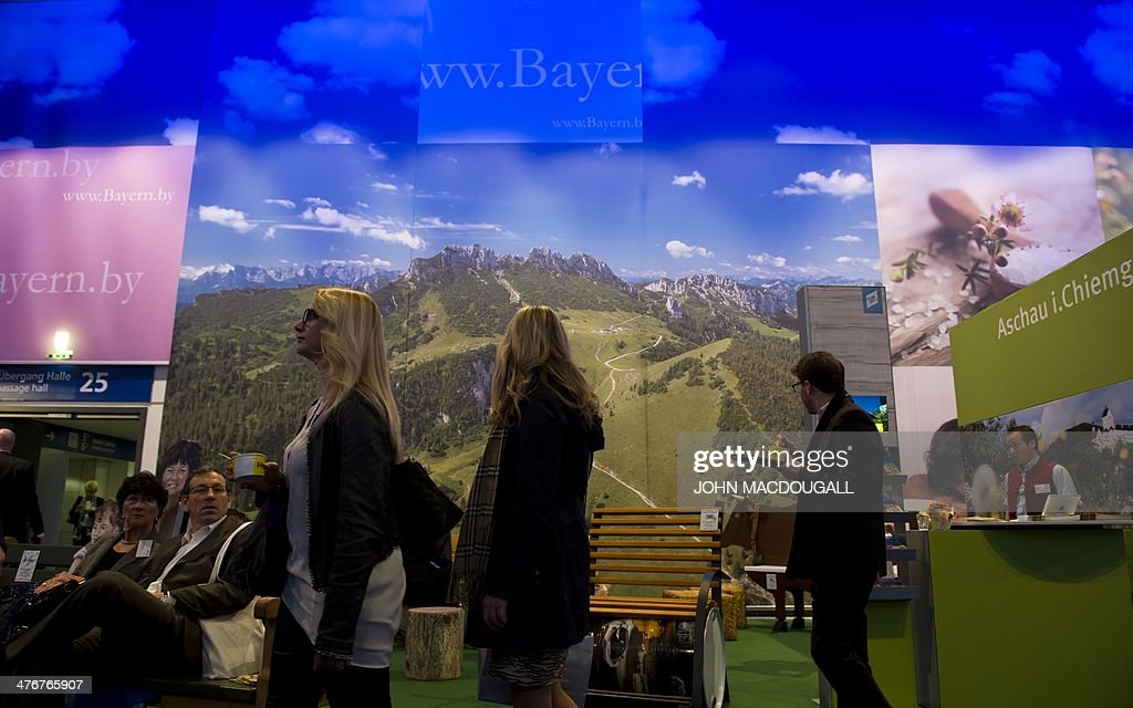 Fair-goers visit the Bavaria stand at the ITB International Travel Trade Fair in Berlin March 5, 2014. The ITB opens from March 5 to 9, 2014. AFP PHOTO / JOHN MACDOUGALL