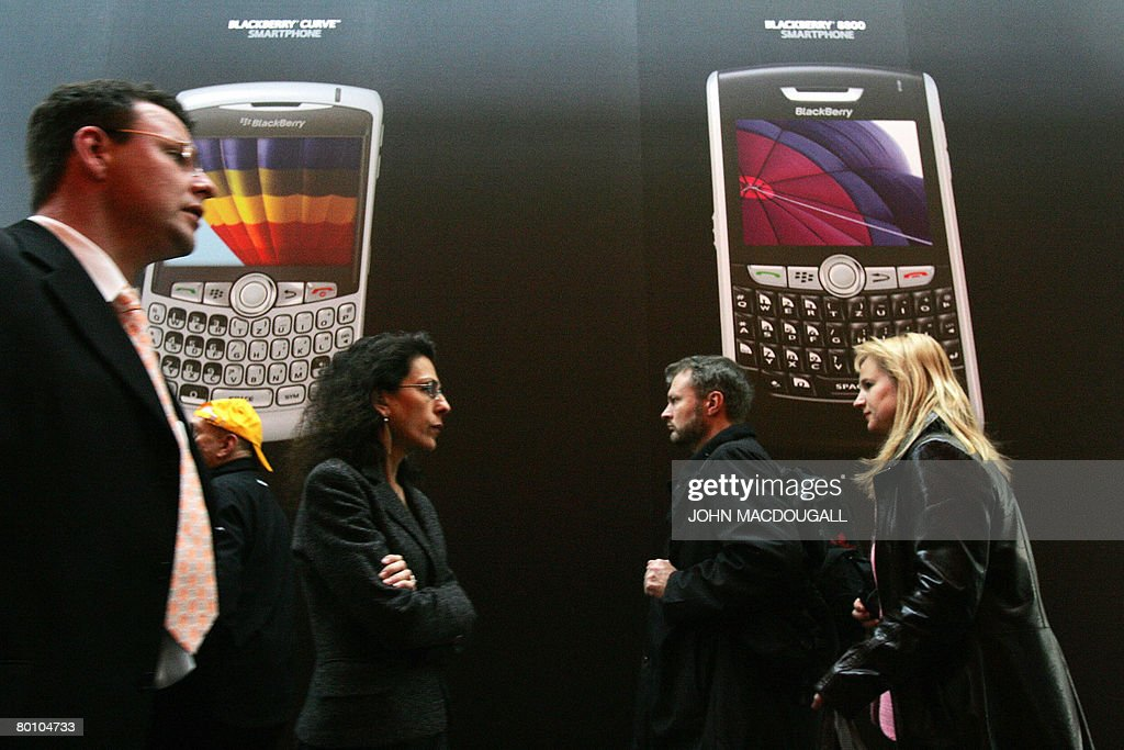 Fairgoers walk past the Blackberry stand at the CeBIT trade fair in Hanover on March 4, 2008. The world's biggest high-tech fair runs from March 04 to 09 and will draw some 5,000 exhibitors.