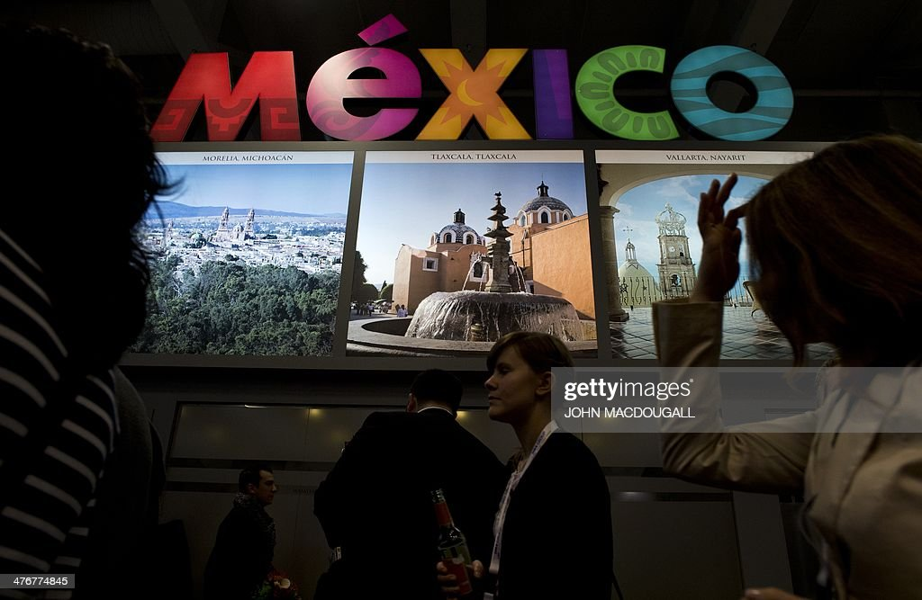 Fair-goers walk past the Mexico stand at the ITB International Travel Trade Fair in Berlin on March 5, 2014. The ITB opens from March 5 to 9, 2014. Mexico is this year's guest of honour.