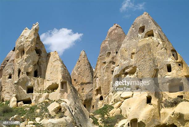 Fairy chimneys filled with houses near the village of Uçhisar in Cappadocia Turkey The landscape in Cappadocia is formed from compacted volcanic ash...