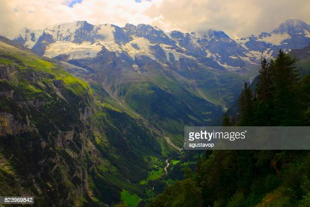 Fairy tale landscape: Jungfrau, Eiger and Monch massif and glaciers above idyllic Kleine Scheidegg - Grindelwald and Lauterbrunnen alpine valleys and meadows, dramatic swiss snowcapped alps, idyllic countryside, Bernese Oberland,Swiss Alps, Switzerland