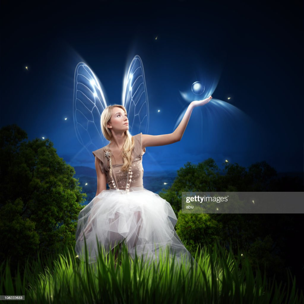 Fairy Woman Holding Orb and Sitting in Grass