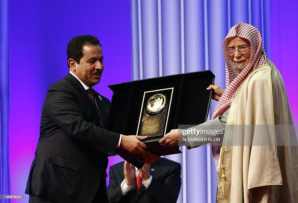 Faisal bin Abdulrahman Bin Muammar (L) Secretary General of the KAICIID Center and Abdullah Al Turki, President of the Islamic League pose with a trophy during the inauguration ceremony of the KAICIID Center (King Abdullah Bin Abdulaziz International Centre for Interreligious and Intercultural Dialogue) held at the Hofburg in Vienna on November 26, 2012.