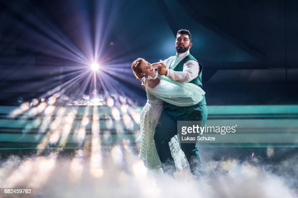 Faisal Kawusi and Oana Nechiti perfom on stage during the 8th show of the tenth season of the television competition 'Let's Dance' on May 12 2017 in...