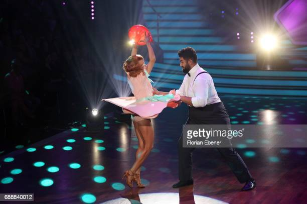 Faisal Kawusi and Oana Nechiti perform on stage during the 10th show of the tenth season of the television competition 'Let's Dance' on May 26 2017...