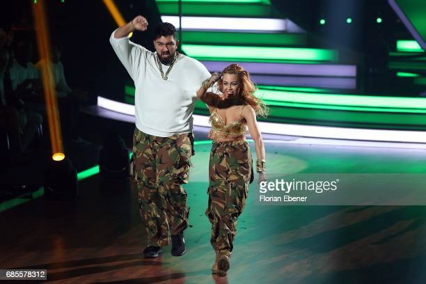Faisal Kawusi Oana Nechiti Heinrich Popow and Kathrin Menzinger Heinrich PopowKathrin Menzinger perform on stage during the 9th show of the tenth...