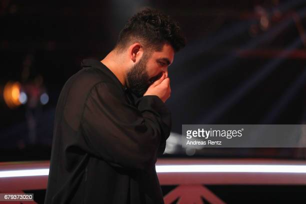 Faisal Kawusi reacts on stage during the 7th show of the tenth season of the television competition 'Let's Dance' on May 5 2017 in Cologne Germany
