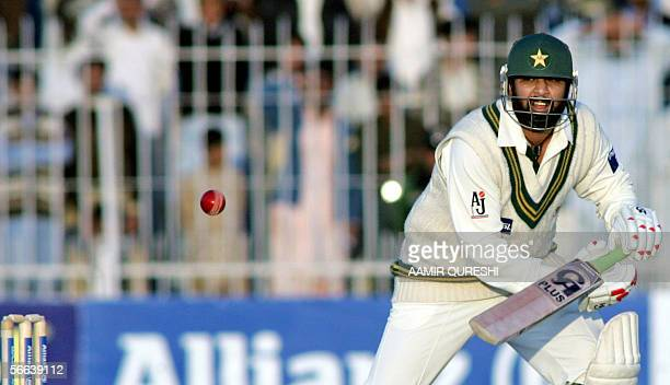 Pakistani cricket captain InzamamulHaq watches the ball after he plays a shot during the first day of the second cricket Test match between Pakistan...