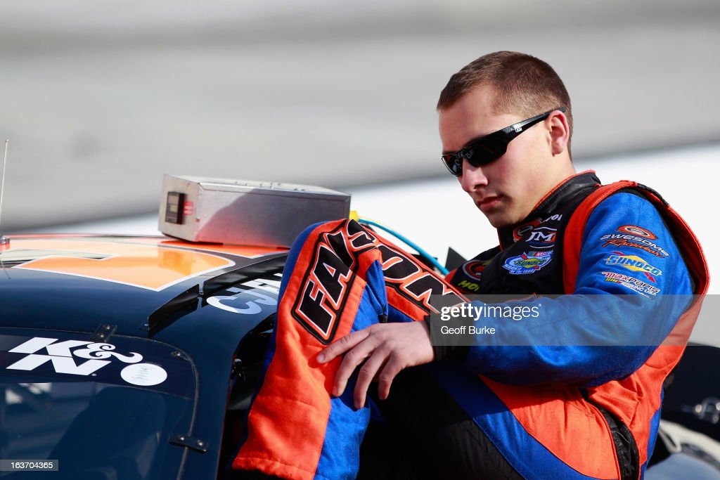 CJ Faison, driver of the #39 Sherwin-Williams Chevrolet, climbs into his car during qualifying for the NASCAR K&N Pro Series East DRIVE4COPD 125 at Bristol Motor Speedway on March 14, 2013 in Bristol, Tennessee.